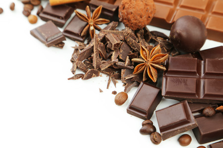 lactic: Dark chocolate bar with coffee beans and star anise on white background