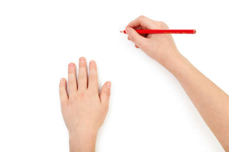hand pen: Childs hands drawing on a white paper