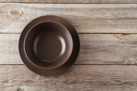 empty bowl: Empty bowl on grey wooden background