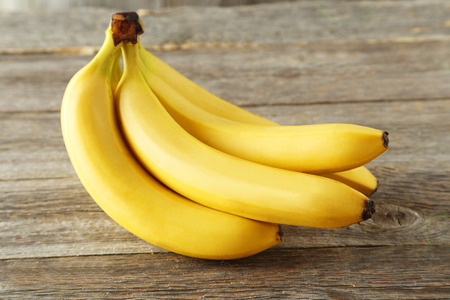 banana skin: Bunch of bananas on grey wooden background