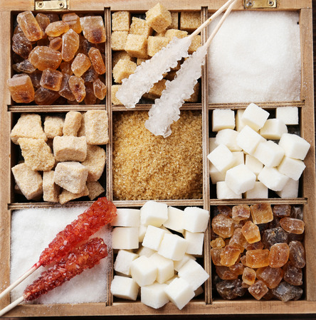hyperglycemia: Various kinds of sugar in wooden box on brown wooden background