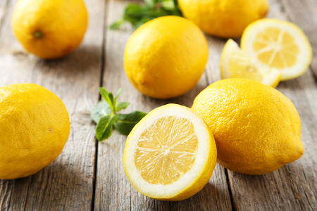 Lemons on grey wooden background