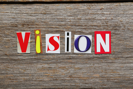 foresight: The word vision in cut out magazine letters