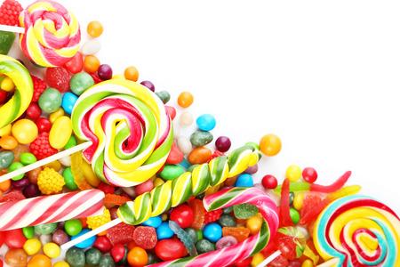 rainbow stripe: Different fruit candies on white background Stock Photo
