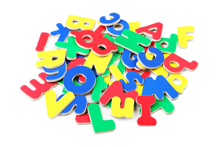 Magnetic plastic letters isolated on white photo