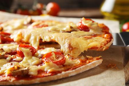 peice: Fresh tasty pizza on cutting board Stock Photo
