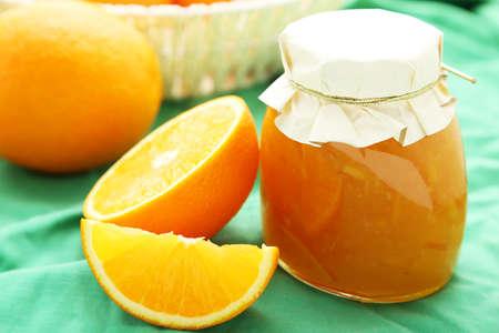 Orange jam on green background photo