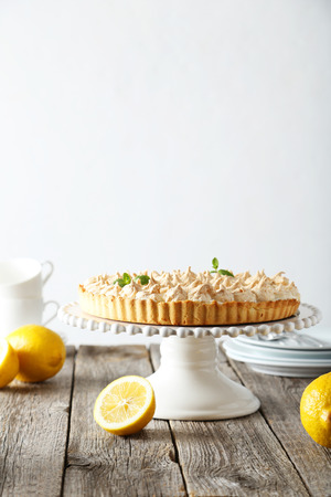 cake stand: Lemon meringue pie on cake stand on grey wooden background