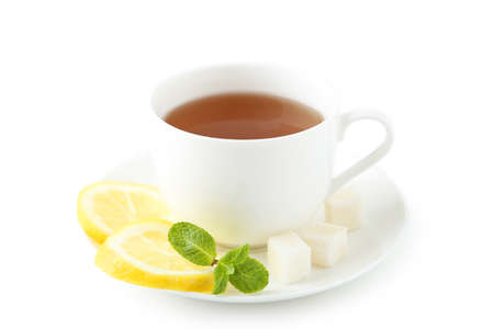 Cup of tea with mint and lemon isolated on white photo