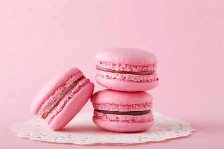 French pink macarons on pink background Standard-Bild