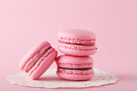 pink: French pink macarons on pink background Stock Photo