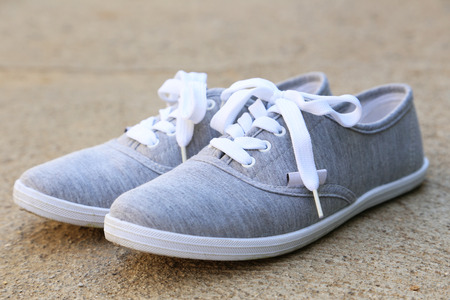 athletic wear: Pair of grey shoes outdoors