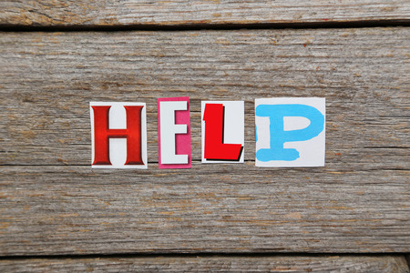 helping others: The word Help in cut out magazine letters