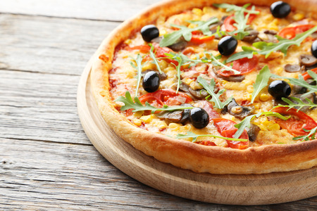 Fresh tasty pizza on grey wooden background Stock Photo