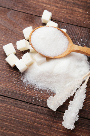 hyperglycemia: White sugar on brown wooden background