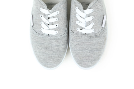 athletic wear: Pair of grey shoes on white background