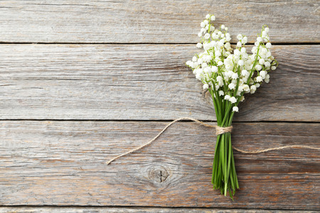 mayflower: Lily of the Valley on grey wooden background