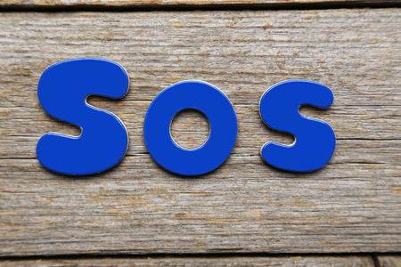 magnets: Sos word made of colorful magnets