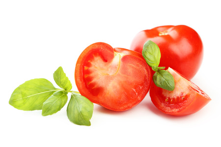 peice: Tomatoes and basil leaves isolated on white