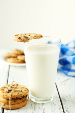 dairying: Glass of milk on white wooden background Stock Photo