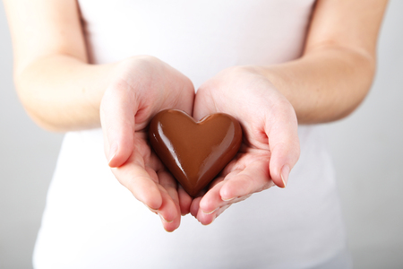 womans hands: Womans hands with chocolate heart