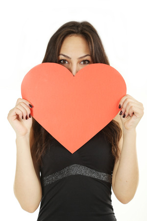 Beautiful woman with valentines day heart on white background photo