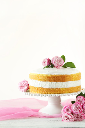 cake stand: Sweet cake on cake stand on white wooden background