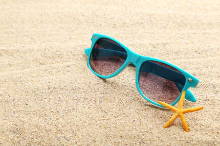 glasses in the sand: Starfish with glasses on a beach sand Stock Photo