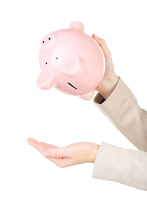 shaking out: Shaking out empty piggy bank Stock Photo
