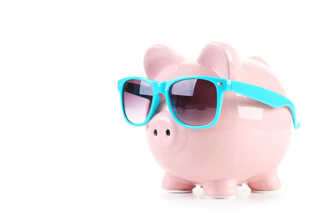 Pink piggy bank with glasses isolated on a white 版權商用圖片