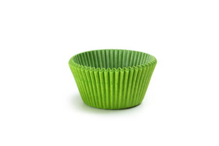 cupcakes: Green empty cupcake cases isolated on white