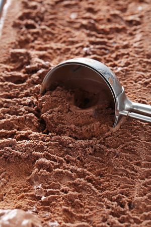 rich flavor: Chocolate ice cream scooped out from container