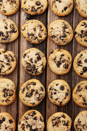 morsels: Chocolate chip cookies on brown wooden background