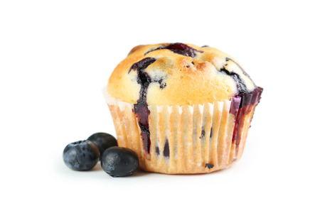 Tasty blueberry muffin isolated on a white