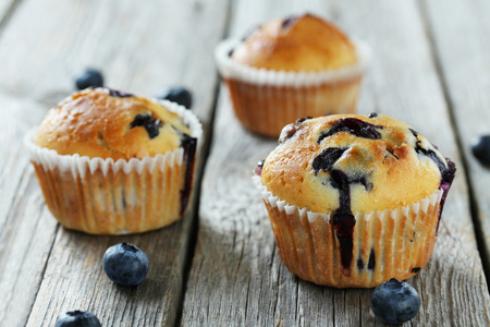 blueberry muffin: Tasty blueberry muffins on a grey wooden background Stock Photo