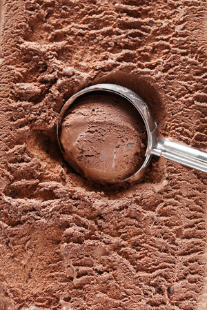 scoop: Chocolate ice cream scooped out from container
