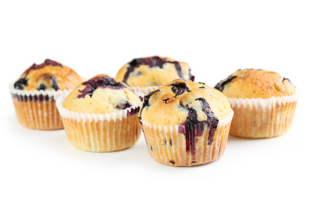 blueberry muffin: Tasty blueberry muffins isolated on a white