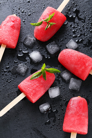 Watermelon popsicle on the black wooden table Stock Photo
