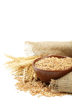wheat grain: Ears of wheat and bowl of wheat grains on white background