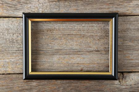 Wooden frame on grey wooden background Archivio Fotografico
