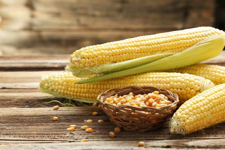 Corns on a brown wooden background Foto de archivo