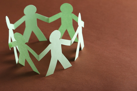 Paper people on the brown paper background