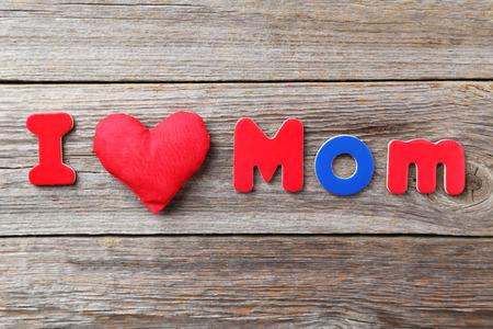 I love mom alphabet on wooden background