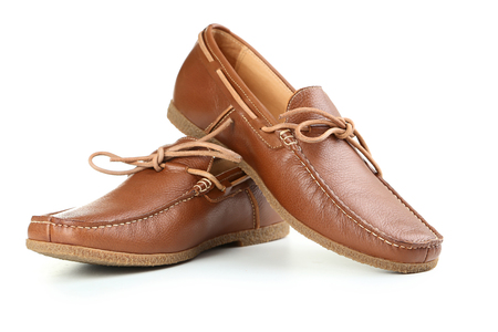 Fashion brown shoes isolated on a white 版權商用圖片