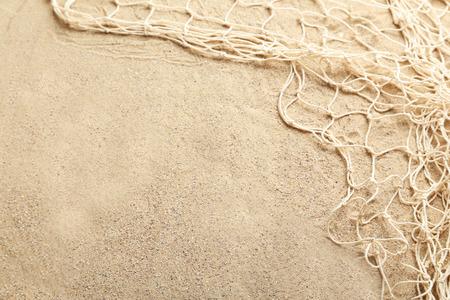 Visnet op een strand zand Stockfoto