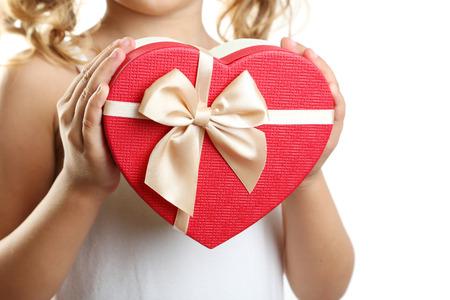 birthday present: Childs hand holding beautiful gift box Stock Photo