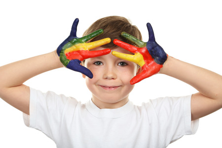 white colour: Portrait of beautiful little boy with paints on hands isolated on white