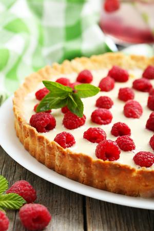 sweet tart: Sweet tart cake with raspberries on grey wooden background