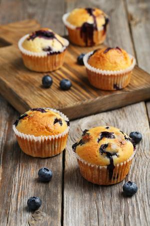 Tasty blueberry muffins on a grey wooden background Zdjęcie Seryjne