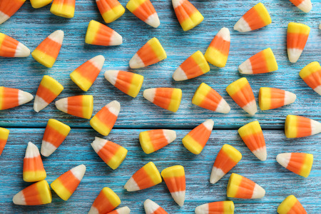 sweet corn: Halloween candy corns on blue wooden background